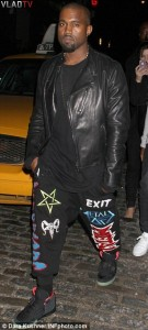 Kanye West sporting an upside down pentagram and Baphomet head on his pants Source
