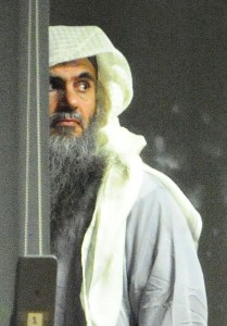Abu_Qatada_and_escort_prior_to_take_off_(cropped)