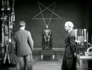 The robot made to control the masses through lust, birthed under an inverted pentagram Source