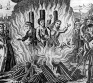 Women being burnt at the stake after being accused of witchcraft