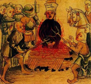 "A ""heretic"" being burnt at the stake in an instance of religious intolerance during the Inquisition"